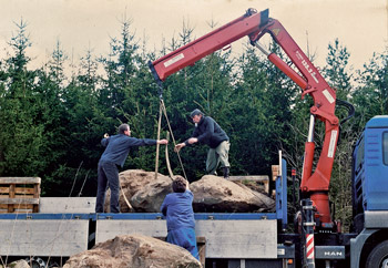 Lubo Kristek installing the sculpture The Wishing Stones